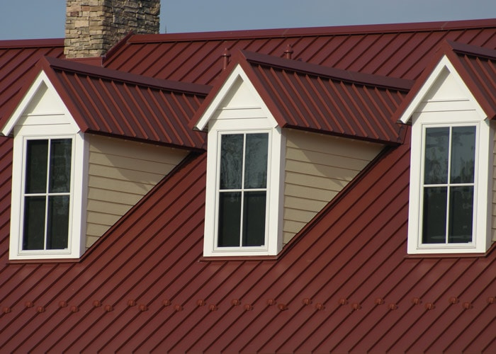 house with metal roofing services